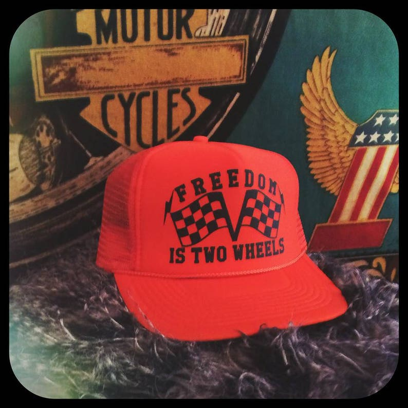 545828418357d Freedom is two wheels checkered flags orange adjustable