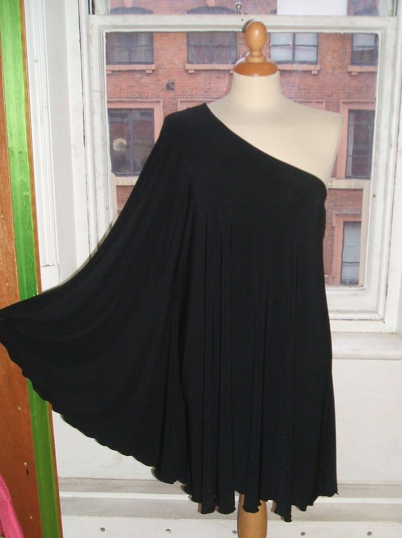70s Jackets, Furs, Vests, Ponchos     Baylis & Knight STUDIO 54 Batwing 70s Disco Glam One Shoulder Bat Wing Dress Black Elegant (Smock) $60.18 AT vintagedancer.com