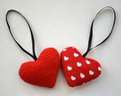 4 small hearts in red and white fabric