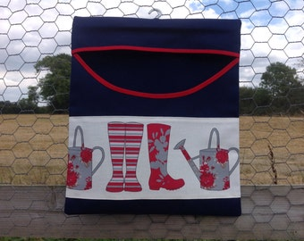 Strong country look peg bag navy blue with wellie and watering can decoration.