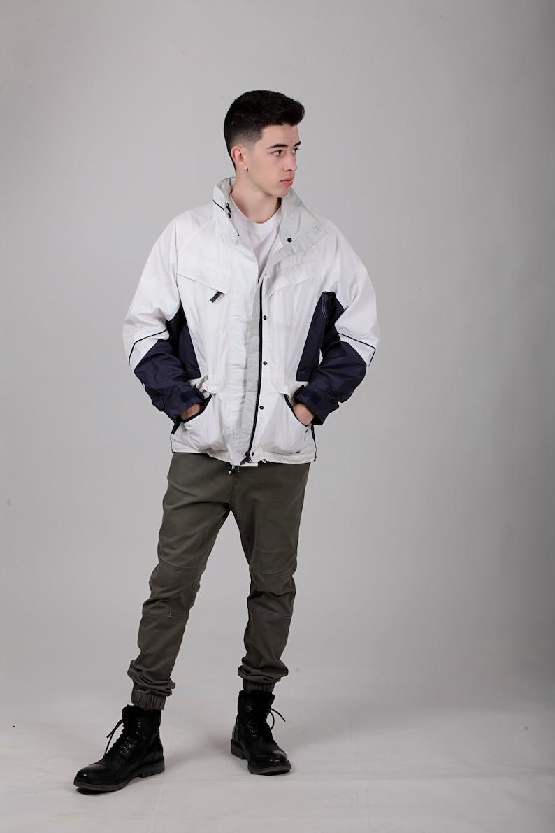 Size S Germany. Vintage White Outdoors Jacket