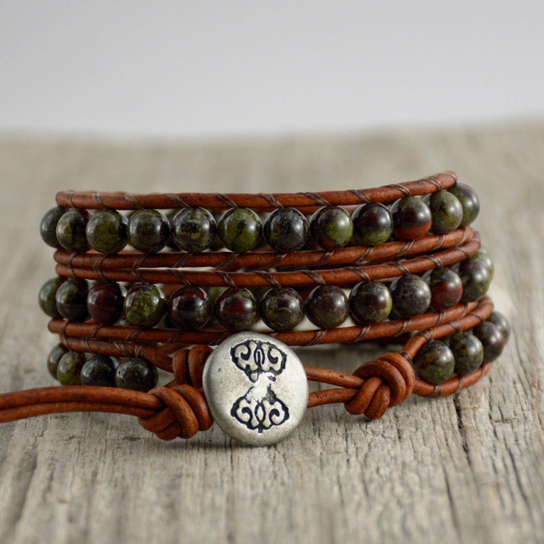 c74ffb88f344 Dragon blood stone beaded bracelet. Triple wrap leather