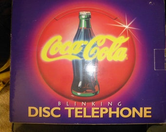 1995 Coca Cola Disc Telephone   Light Up Wall Or Desk Form   NEW IN BOX    Mint Condition   Office Or Home   Lights When Ringing