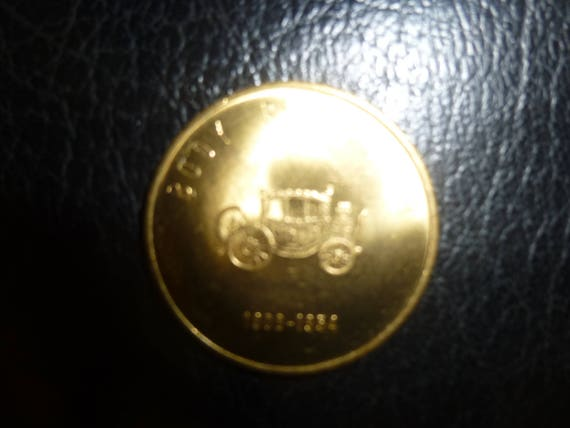 GM 1st 50 Million Cars Souvenier Brass Coin - 1954 - Body by Fisher  1908-1954 - Great condition - unusual form - classic car lover must