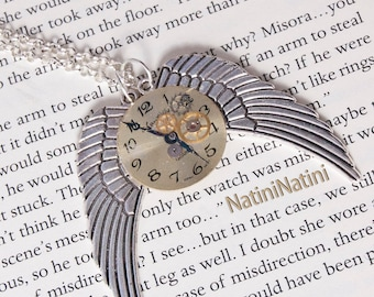 Winged steampunk clock face