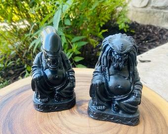 Alien or Predator AVP Amusing Villain Buddhas.