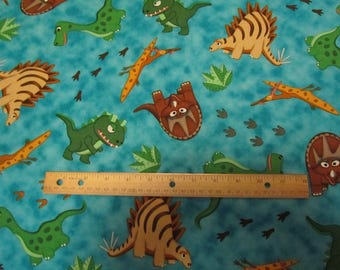 Teal Blue with Multicolored Dinosaurs  Cotton Fabric by the Yard