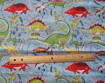 Blue with Multicolored Dinosaurs Flannel Fabric by the Yard
