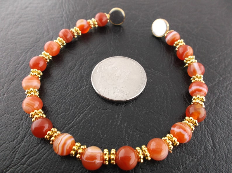Red striped agate gemstone gold flower roundel womens secure easy to connect magnetic clasp bracelet
