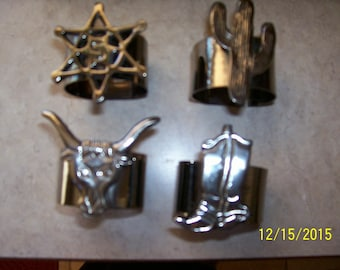 Southwestern napkin rings. set of 4, each different, new