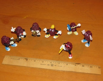 Save 10% Now!  Vintage 1980s California Raisins Lot of Seven!  Saxophone, Surfboard, Skates, Microphone, Boombox, Horn, Hands!