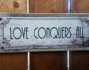 "Recycled wood framed ""Love Conquers All"" street sign"
