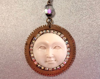 Moon face on watch gear pendant surrounded by rhinestones necklace