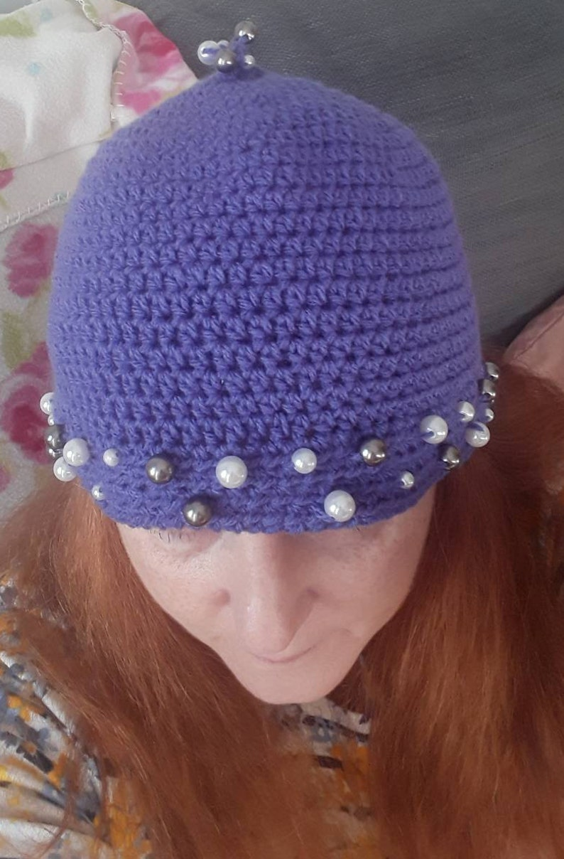 womans hand crocheted Purple winter hat with beaded trim