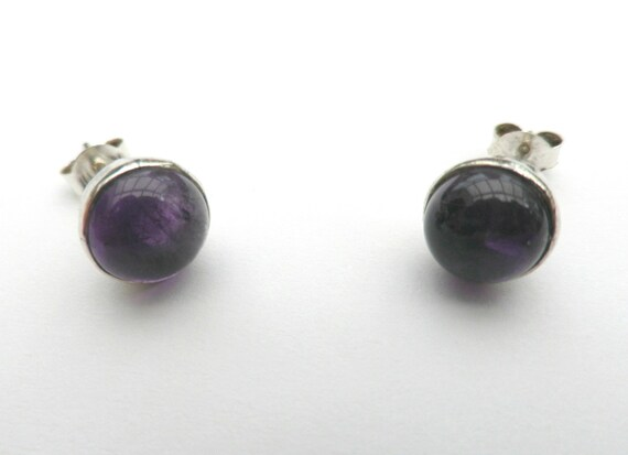 Silver plated stud earrings with round cabochon amethyst glass stones