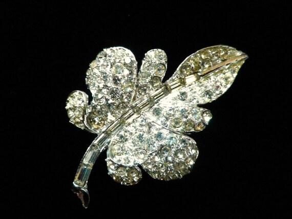 Crystal diamante lobed leaf brooch in silver tone metal, with presentation box