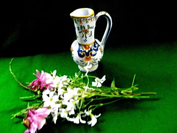 Rouen decorative jug with heraldic decoration in polychrome colours