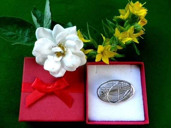Scottish silver brooch in Rennie Mackintosh abstract design with open heart