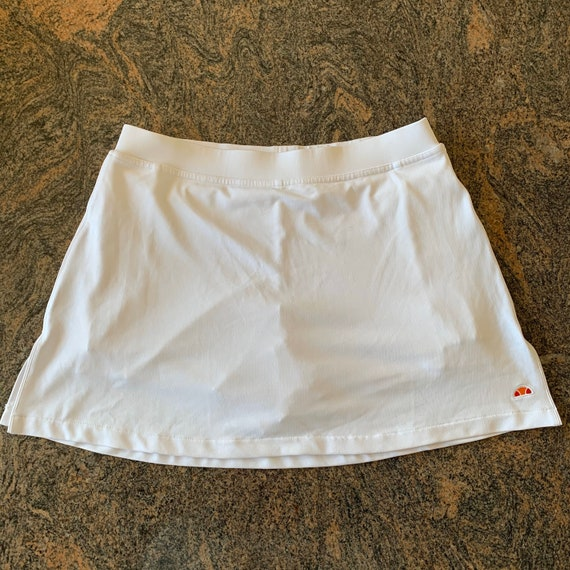 White vintage Ellesse tennis skirt with white shor