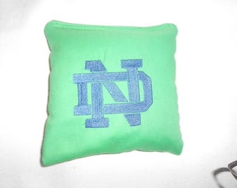 Green with Blue lettering N D Embroidered Corn hole Bags