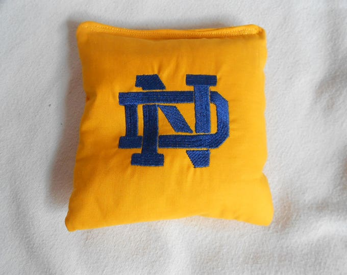 Gold  with blue lettering  N D Embroidered Corn hole Bags