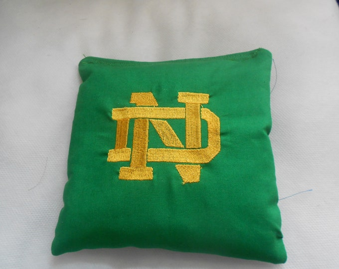 Green with Gold lettering N D Embroidered Corn hole Bags