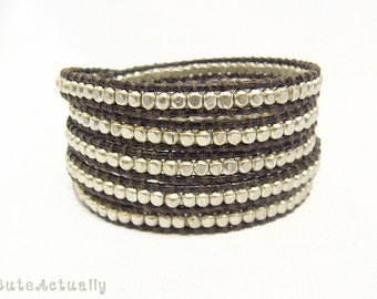 Silver plated beaded wrap bracelet on brown polyester cord