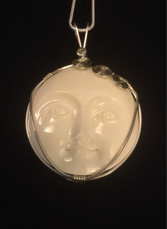 carved bison bone open eyed moon face necklace wire wrapped bison bone face pendant Serene goddess in silver necklace celestial jewelry