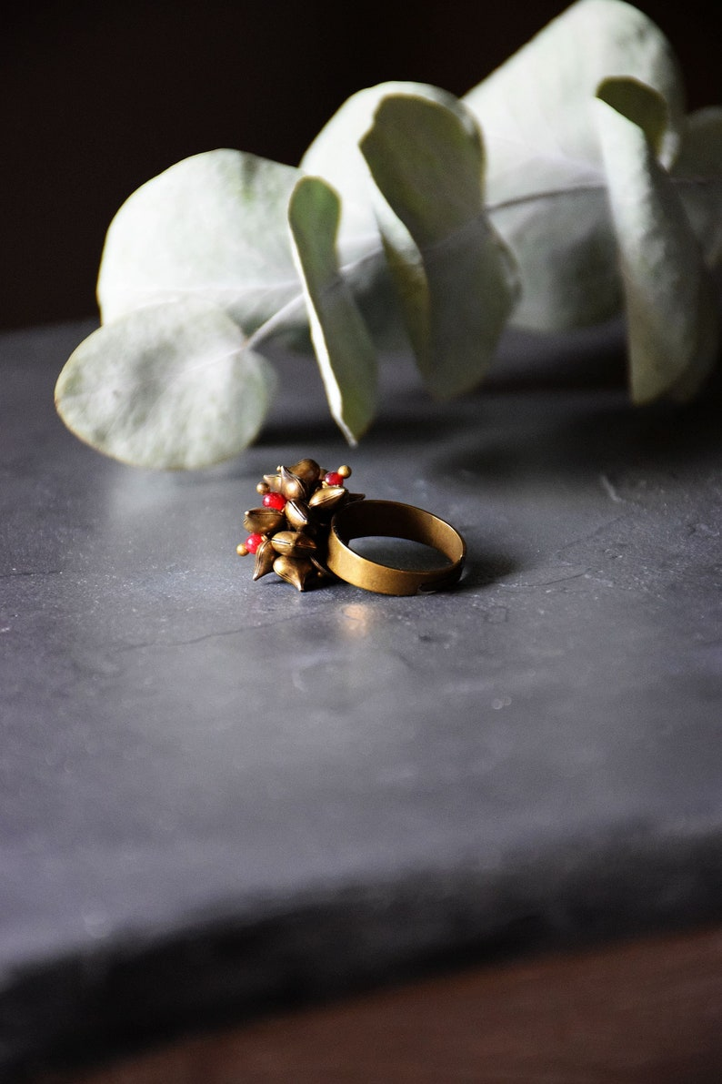 Bronze Adjustable ring with charms hearts and red agate