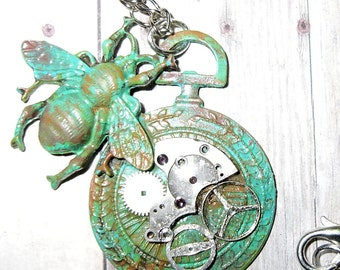 A Busy Steampunk Bee, Alights on an Altered Pocket Watch Pendant.