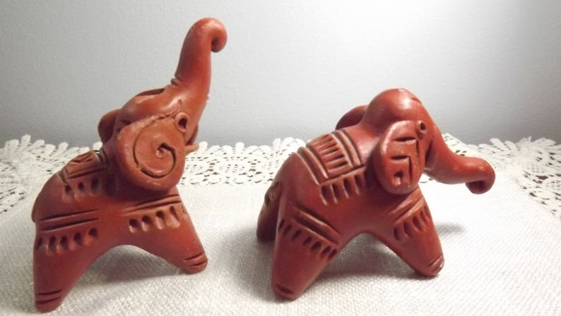 A Pair of Playful Pachyderms Vintage Red Clay Elephants