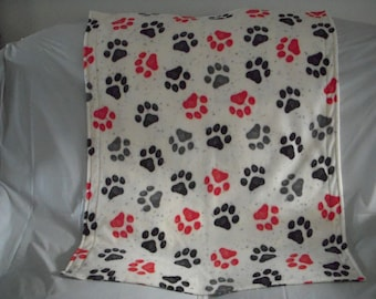 cute little puppies on red print fleece with the same pattern on the reverse side. Doggy Blanket