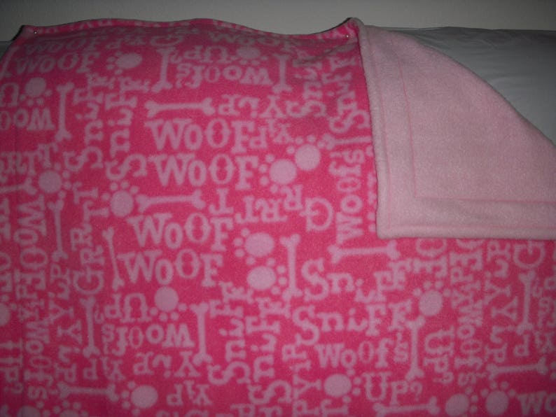 woof sniff dark pinklight pink words wsolid light pink on the reverse side. this fabric says what a dog likes to do Doggy Blanket