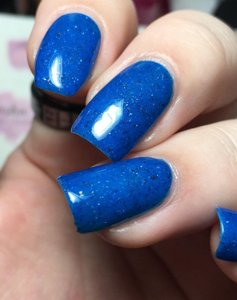 My Dad Was A Space Pirate Nail Polish - deep neon blue jelly with flakies