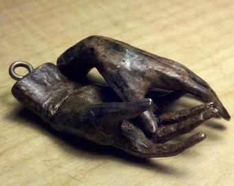 """Bronze sculpture 2"""" long small bronze hands with bronze screw eyes,"""