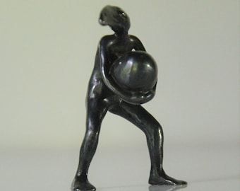 Bird person with egg. Small bronze sculpture