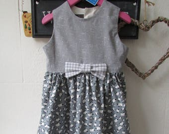 Girls party dress with lovely sheep fabric pattern a bow and lined bodice.   Age 4 years
