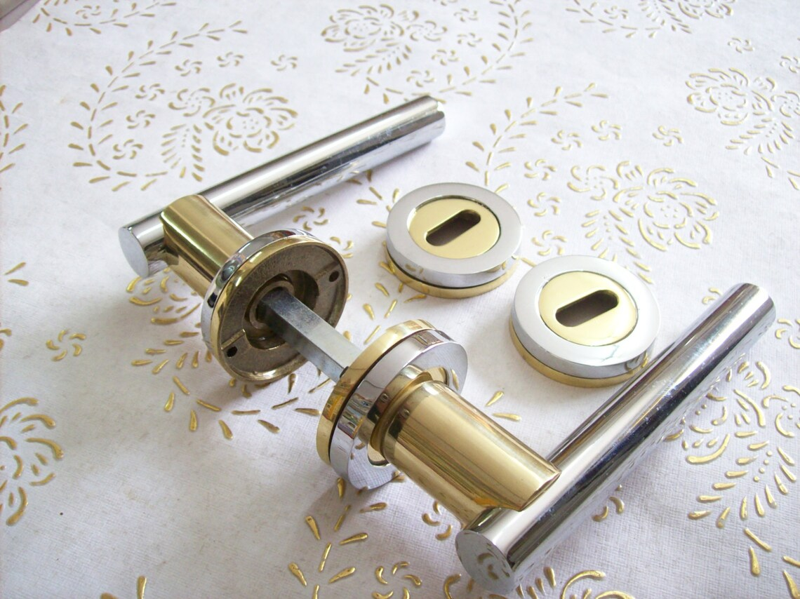 Vintage Italy handle in polished brass gold and chrome high quality.Gold and chrome handles.Italian Designer.Very heavy brass handle.Art1016