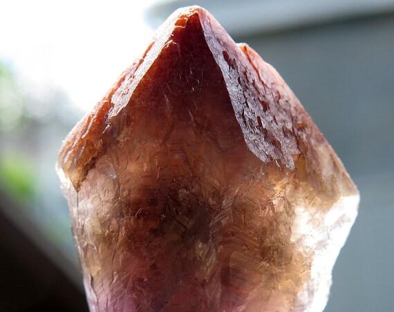 A Red Cap Termination 59 Gram Super Seven Crystal, Espirito Santo (Holy Spirit), in Northern Brazil