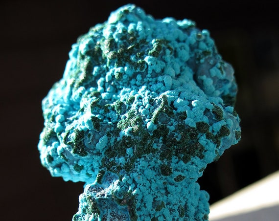 Shock color 3 inch tall Chrysocolla specimen. From the Congo