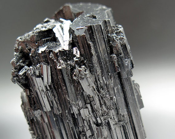 215.3 Gram double terminated Schorl Tourmaline with supreme luster. We go for these when they are DT damage free self standing and perfect.
