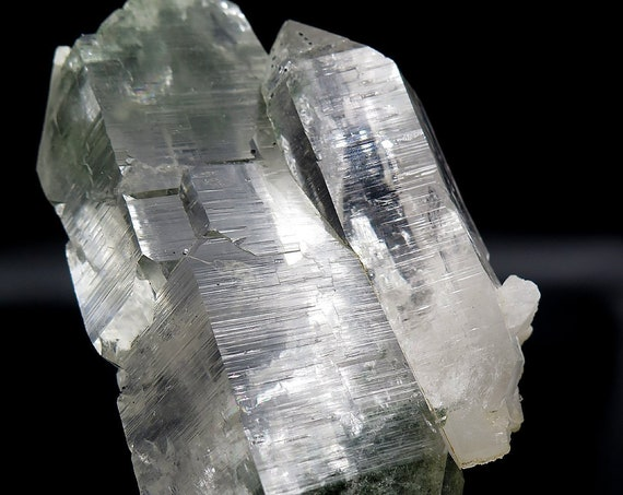 A Chlorite Included Himalayan quartz offered is this unusual Double Terminated with chlorite on both ends and a perfect large side car