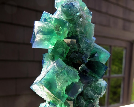 Scarce find. A color change Fluorite stalactite. Diana Maria mine, Frosterley, Weardale Co., Durham, England. 4 inches tall. Stands