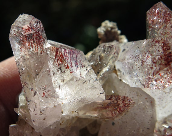 52.6g Heavy hematite included quartz cluster on matrix. Fire red inclusions. Brandberg Mts. Namibia