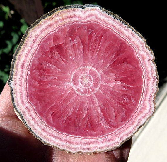 So tough to find a perfect high quality Argentine Rhodochrosite slices. Offering a perfect 3 3/8 across full edge round Polished both sides