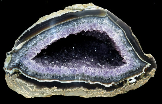 Beautiful 15.75 pound Amethyst Geode with deep pocket. Agate edge is polished all around it's mouth.