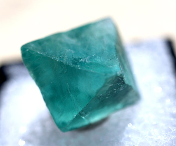 Little gem with great blue green color, transparent Fluorite Octahedron Hunan Prov., China in a perk box