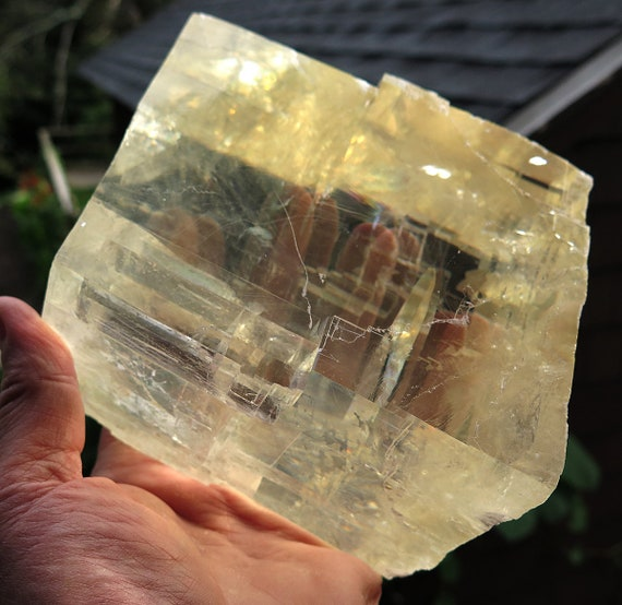 Large 6 pound 1 oz Optical clear Calcite Rough. 5 by 4 by 3 inches thick. Clear with great double Refraction and rainbows