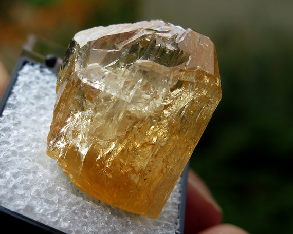 An excellent gemmy Topaz thumbnail at 14.8 grams completely crystallized with no damage. Zambia