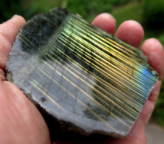 Unusual Labradorite with linear arrangement of flash yet turn the piece and it gives total flash. 247 grams, 4 1/8 inch. Madagascar